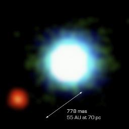 La première photographie d´une planète extra-solaire, vue par le VLT et son optique adaptative